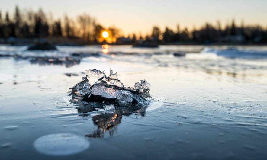 Sun rise above the iced sea