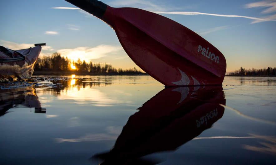 Kayak, sun and blade