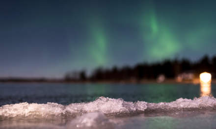 Ice rim with polar light above