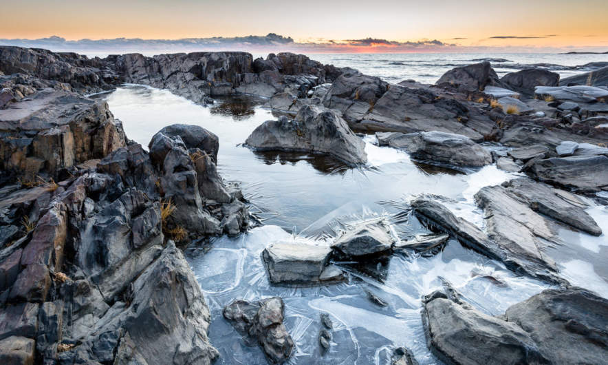 Rocks and frozen puddles at Långhällan