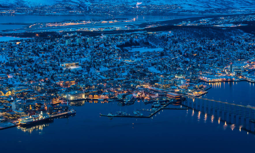 Tromsø by night with Hurtigruten in front