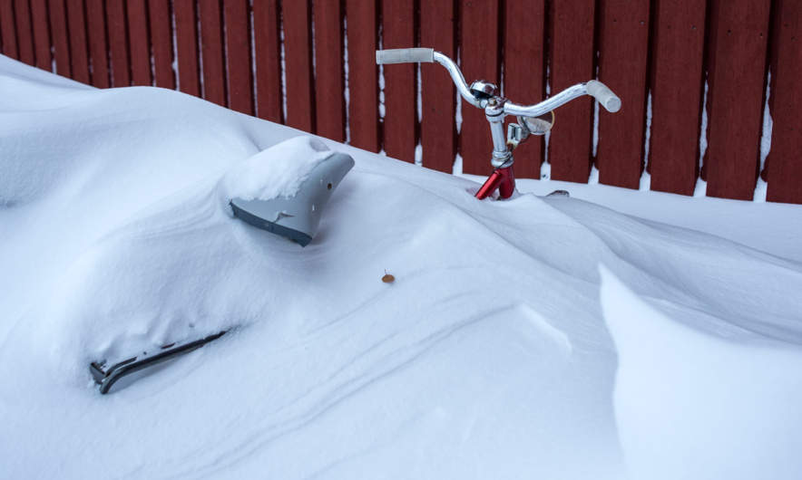 Snowed in bicycle in Abisko