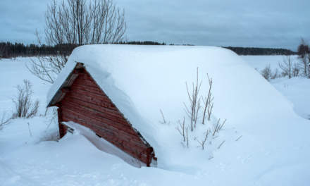 Snow covered hut of the river Torneträsk