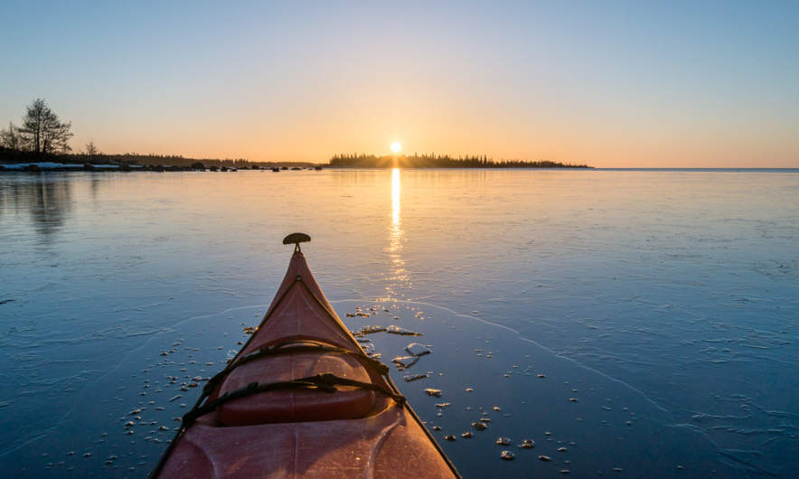 Paddling into the sunrise