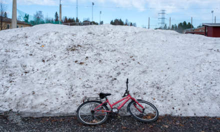 Snow pile with bicycle