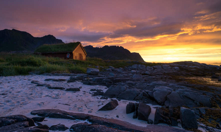 Shed and coast in sunset colours