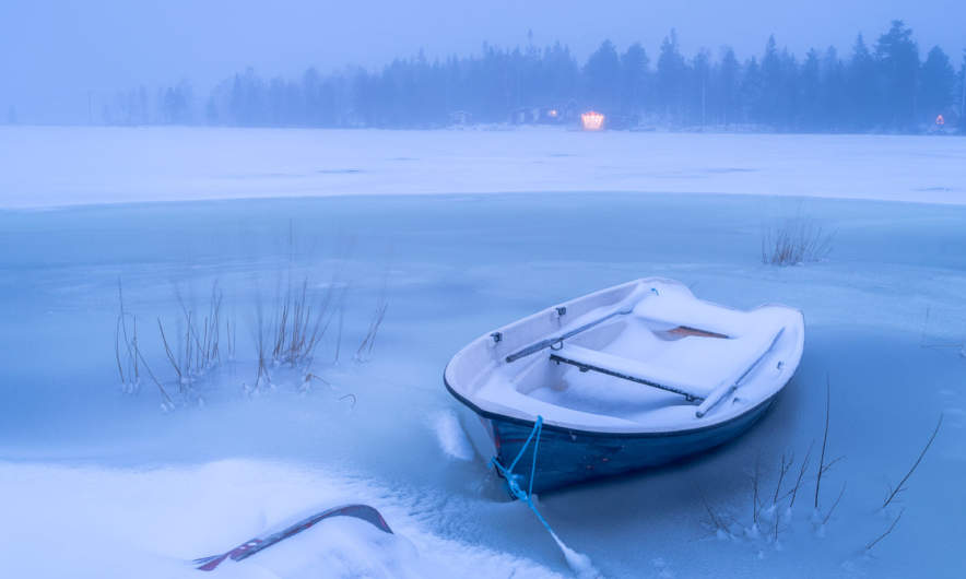 Boat on the wintry beach of Storgrundet