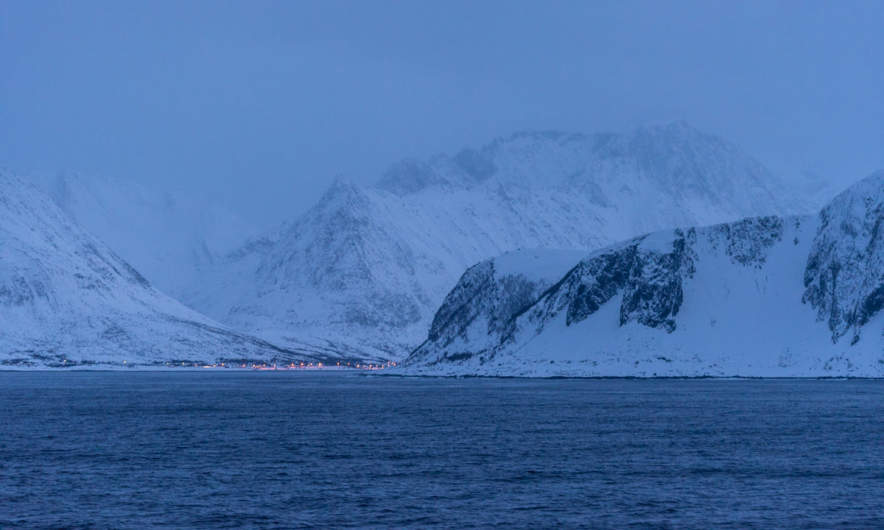 Road along the fjord at nightfall