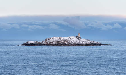 A small rocky island with lighthouse