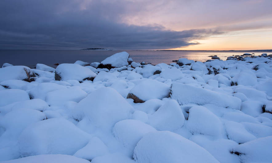 Snow covered rocks at Näsgrundets coast