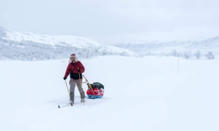 Jonas skiing with his pulka
