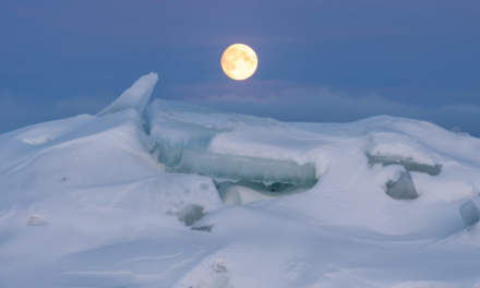 The moon above the icy coast