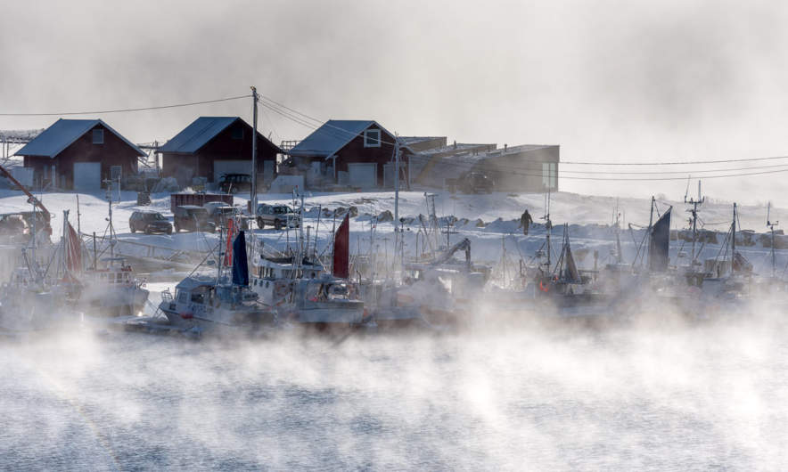 Sea smoke in the harbour of Nesseby