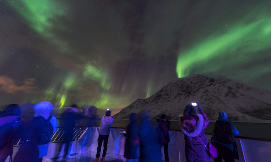 Tourists watching the aurora MS Nordnorge