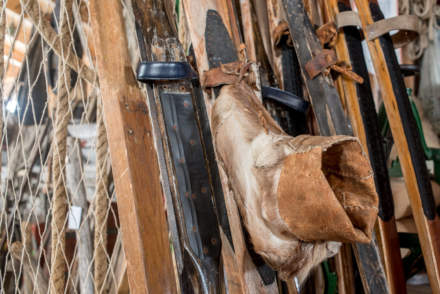 Wooden skis and a boot made of reindeer skin
