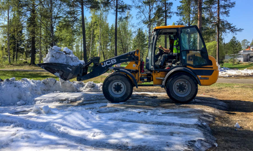 A loader clears snow