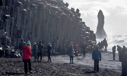 Tourists looking at the basalt columns