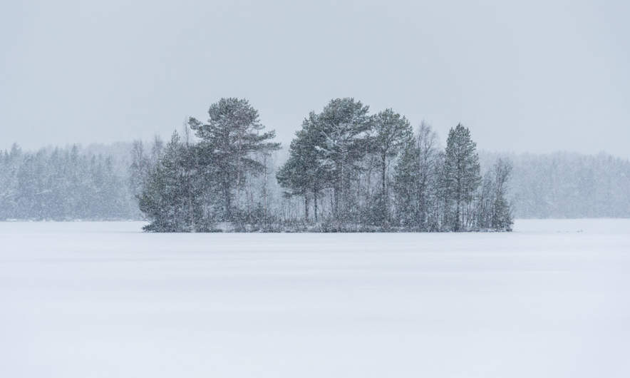 The lake Snesviken is covered with snow