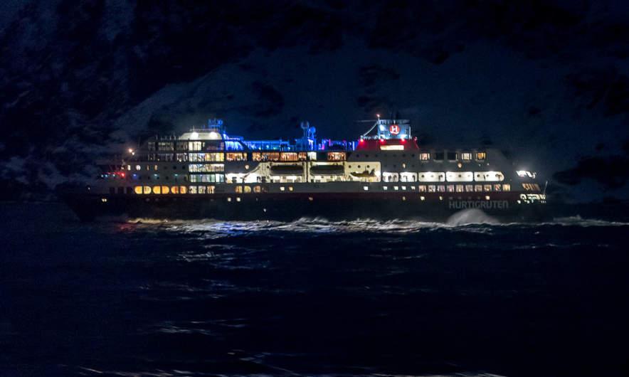 Ms Trollfjord passing in the dark