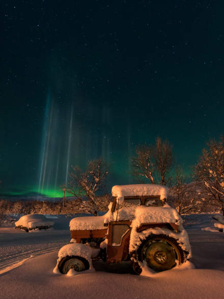 Old tractor and light pillars