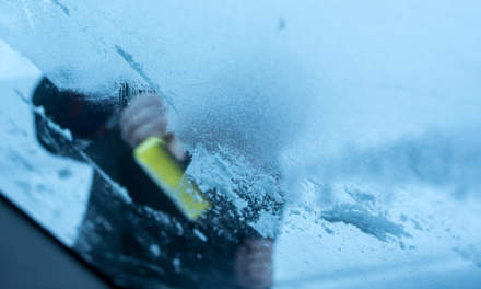 Scraping ice from the windscreen