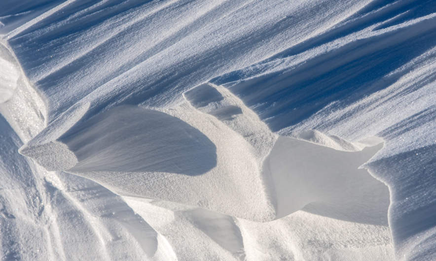 Snow carvings created by the wind