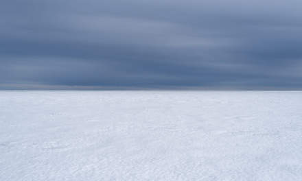 A layer of clouds above the frozen Baltic Sea