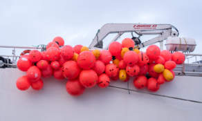 A bunch of bright red buoys on a fishing vessel