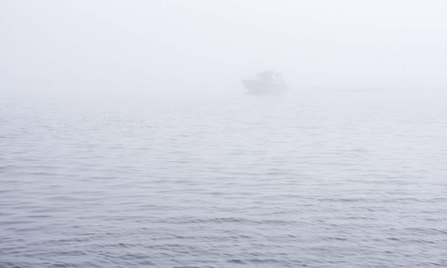 Boat in the sea fog
