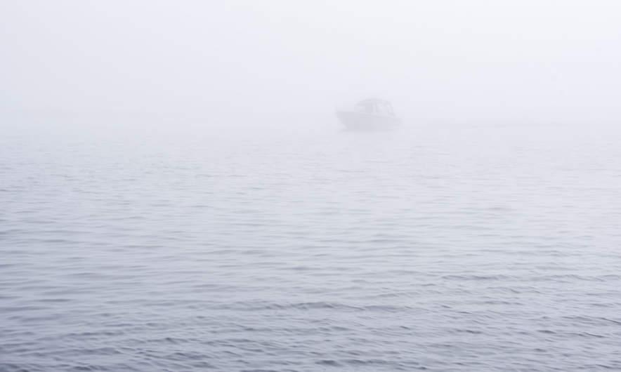 Boat in the sea fog