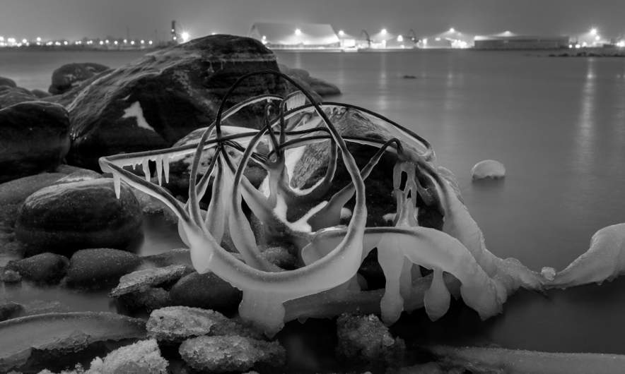 Night shot – ice covered jetsam