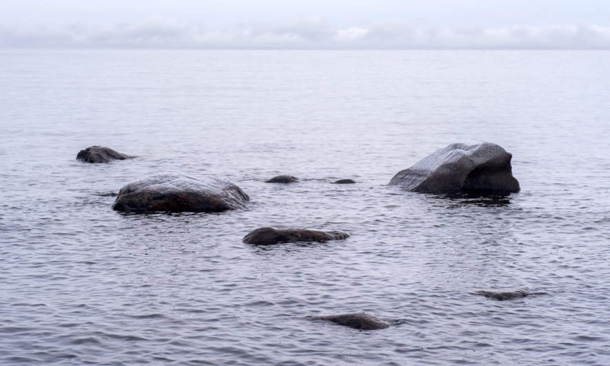 Grey rocks, white sea