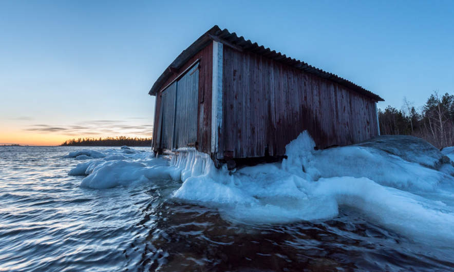 Boat shed by the wintry sea