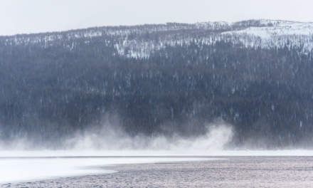 A squall blows snow over the lake