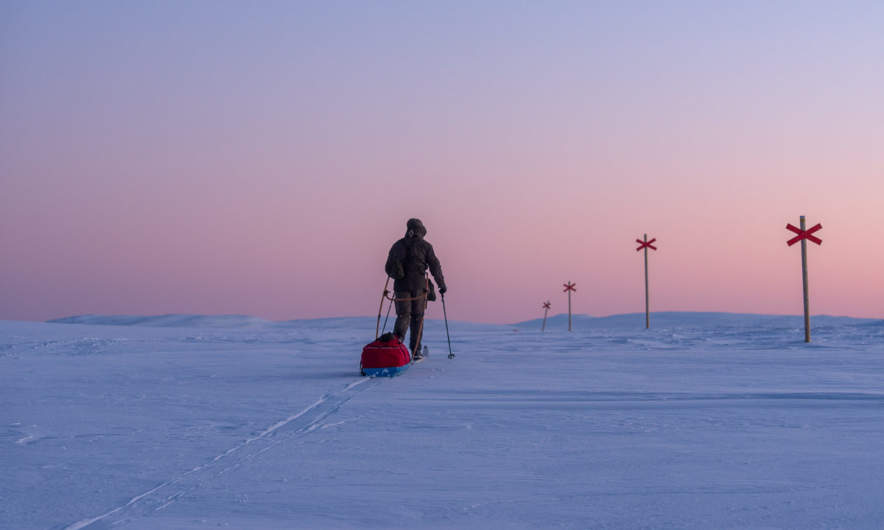 Arne skiing into the nightfall