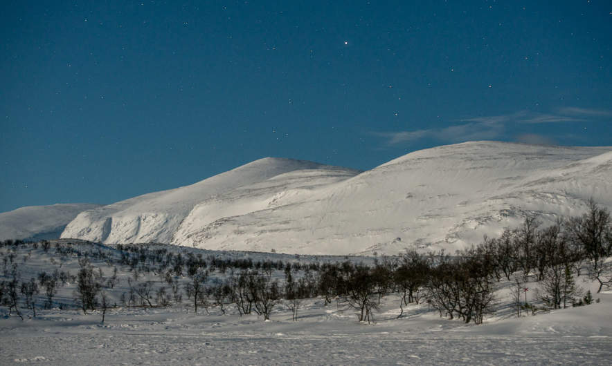 Snowy mountains in the light of the full moon