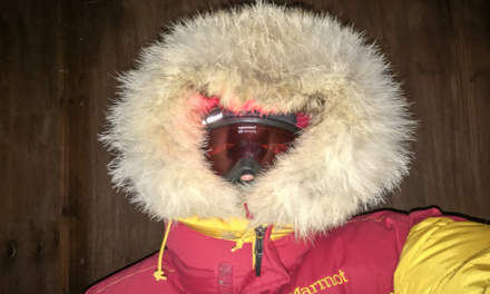 Another toilet selfie – tour jacket, down jacket, balaclava, ski goggles, headlamp