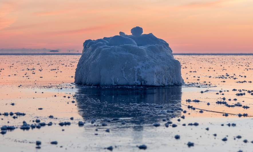 Ice covered rock in the frozen Baltic Sea