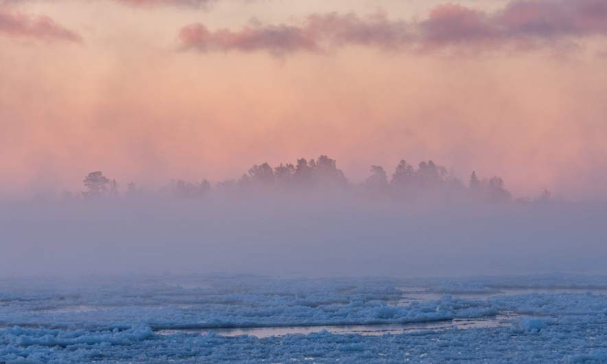 Ice fog in the morning hides the island Bredskärssten