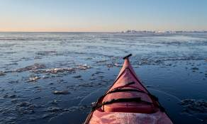 Paddling through slightly thicker ice
